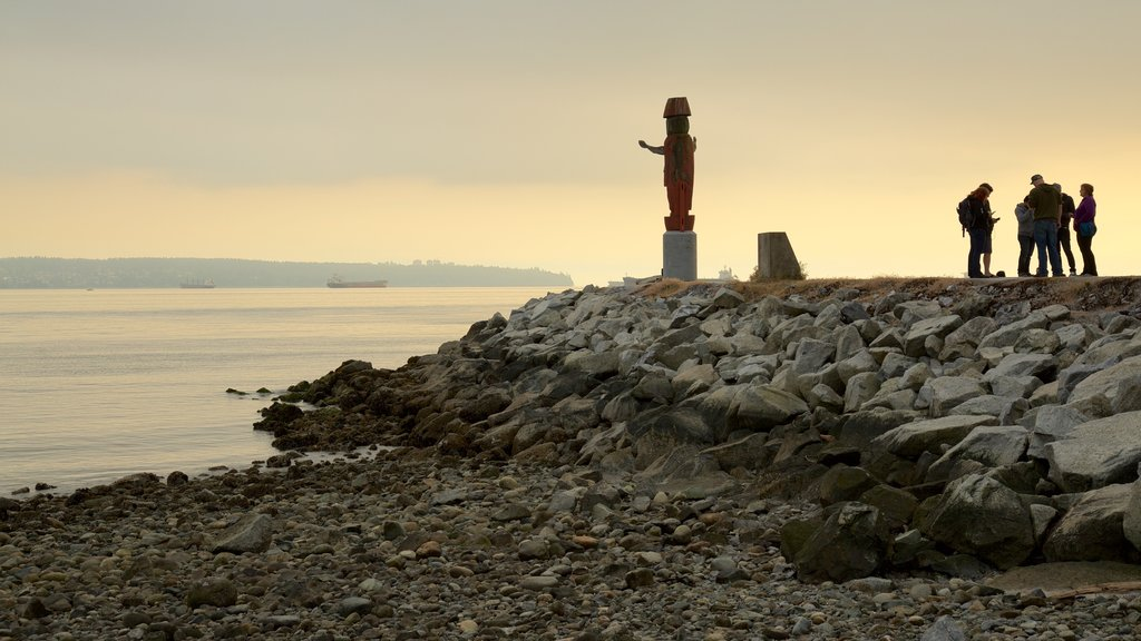 Ambleside Park showing a sunset, general coastal views and a statue or sculpture