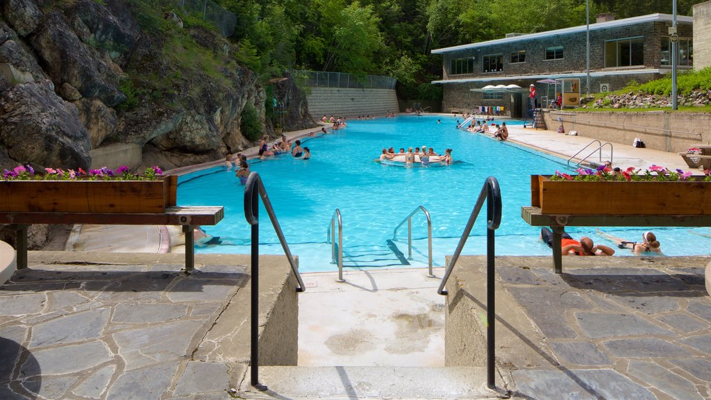 Kootenay National Park featuring a pool and swimming as well as a small group of people