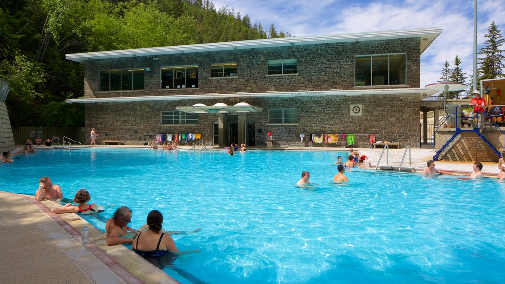 Kootenay National Park showing swimming and a pool as well as a small group of people