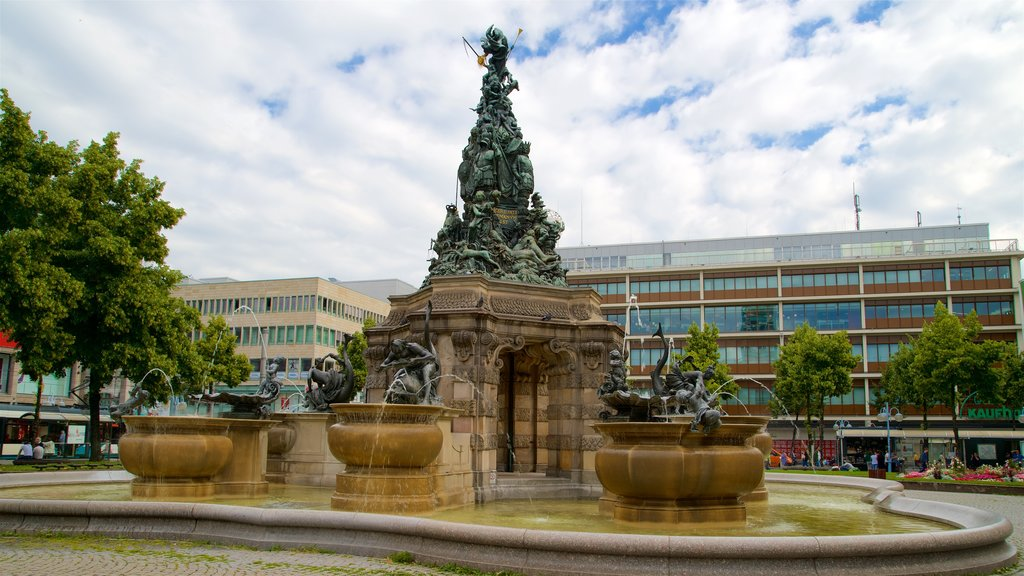 Mannheim featuring a statue or sculpture, a garden and a fountain