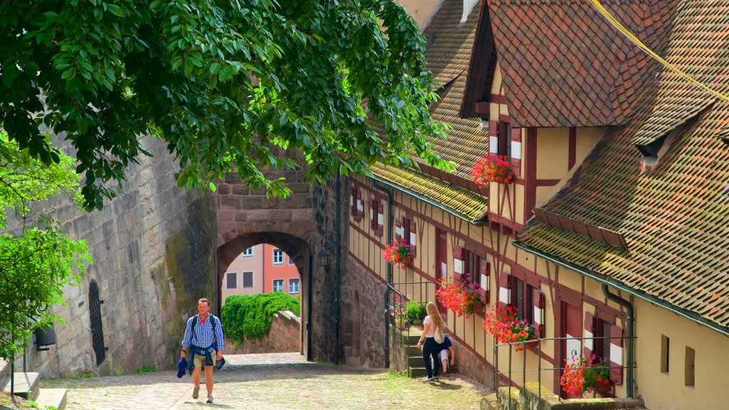 Nuremberg Castle which includes hiking or walking and heritage elements as well as an individual male