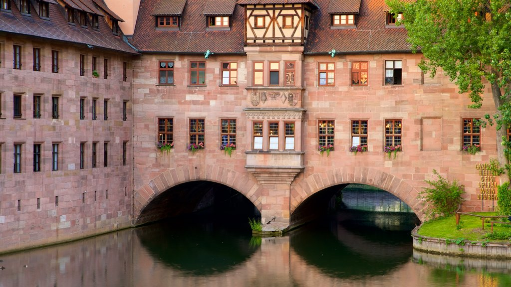 Heilig Geist Spital featuring heritage elements and a river or creek