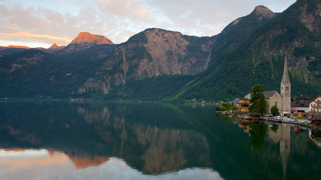 Hallstatt which includes a sunset, a lake or waterhole and mountains