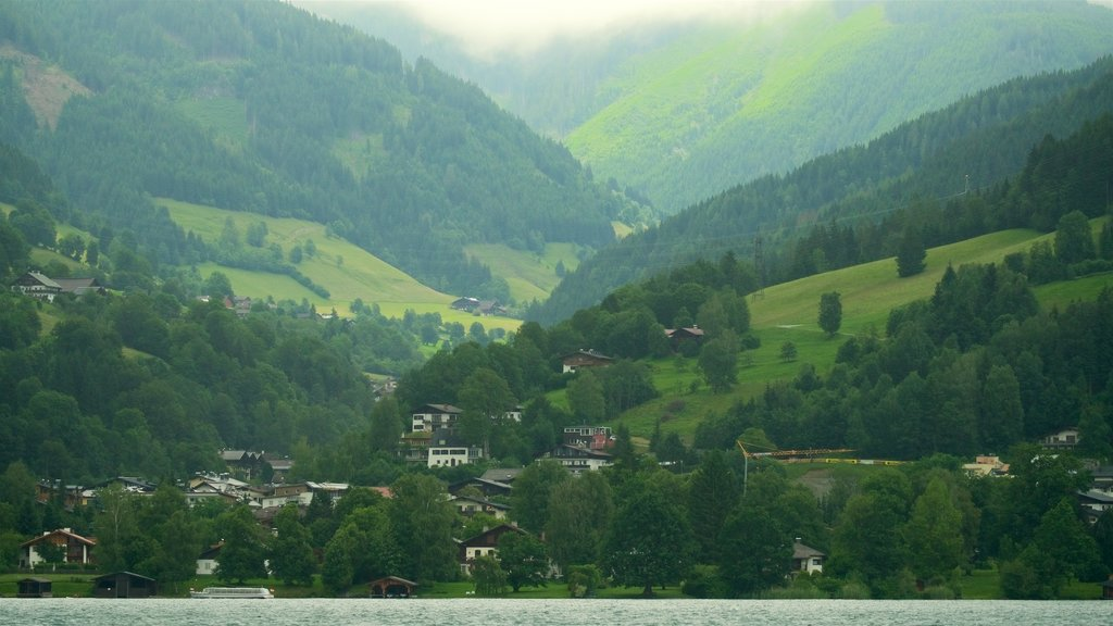 Zell am See - Pinzgau showing a lake or waterhole, a small town or village and mist or fog