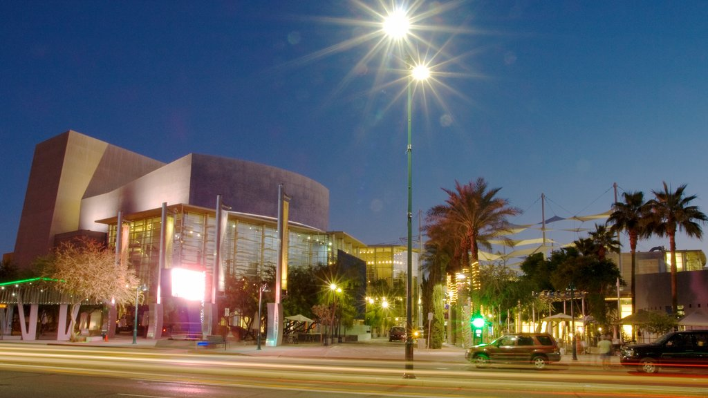 Mesa Arts Center featuring street scenes, night scenes and a city