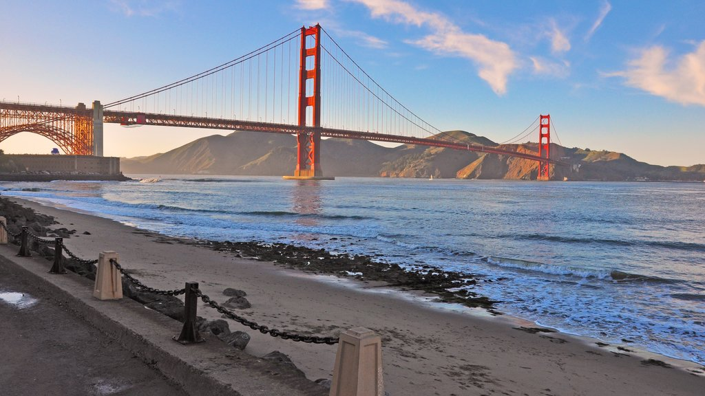 Presidio of San Francisco which includes a sandy beach, landscape views and a suspension bridge or treetop walkway
