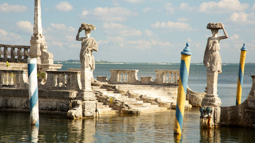 Vizcaya Museum and Gardens which includes general coastal views, a statue or sculpture and landscape views