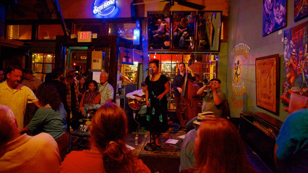 Frenchmen Street Jazz Clubs which includes a bar, interior views and performance art