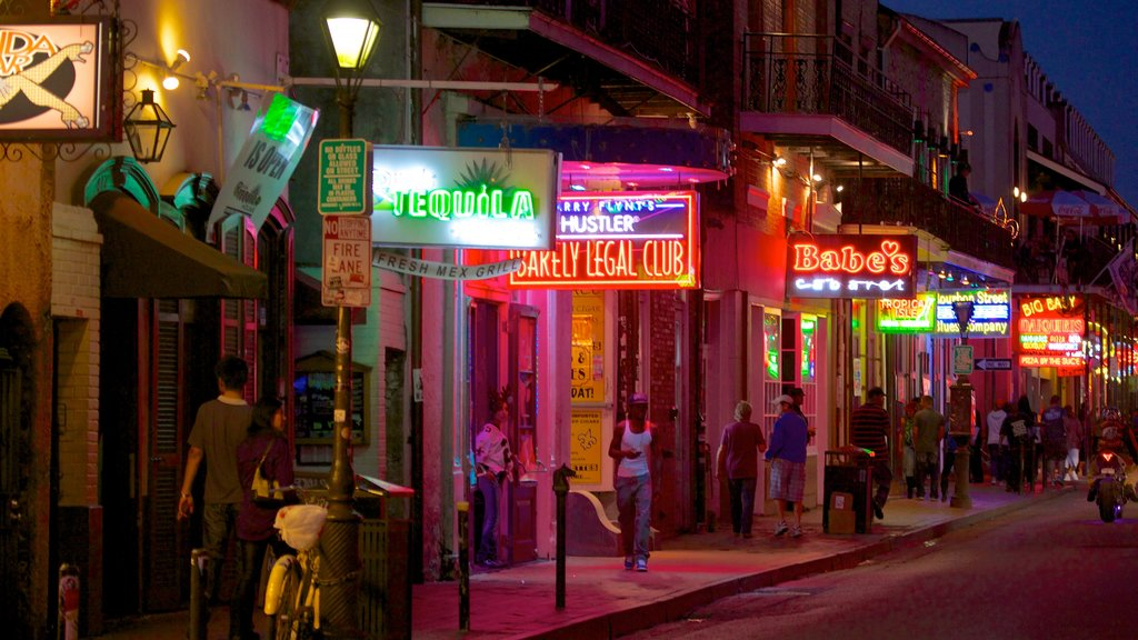 Bourbon Street which includes signage, street scenes and night scenes