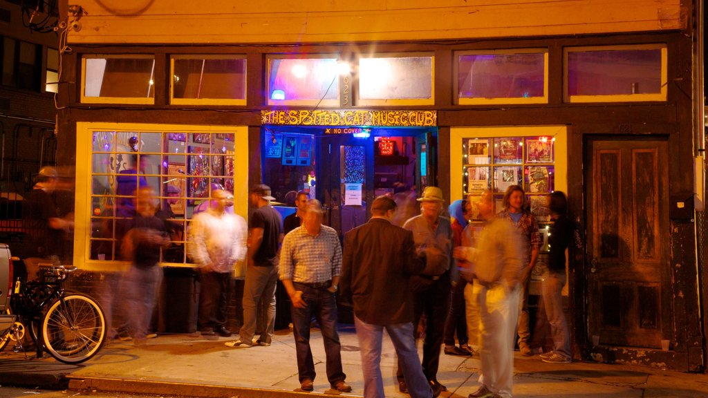 Frenchmen Street Jazz Clubs showing nightlife, night scenes and street scenes