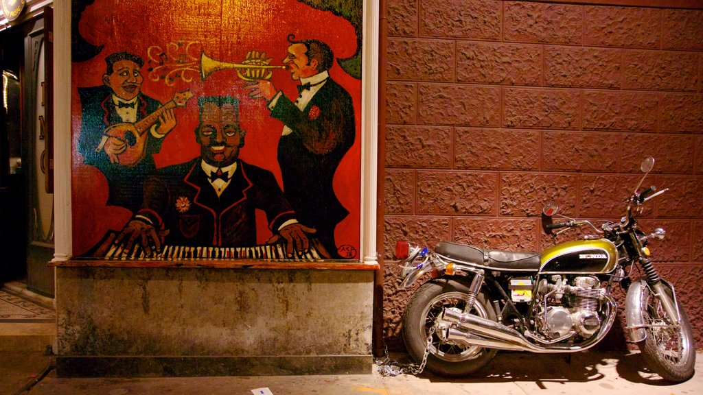 Frenchmen Street Jazz Clubs which includes outdoor art and music