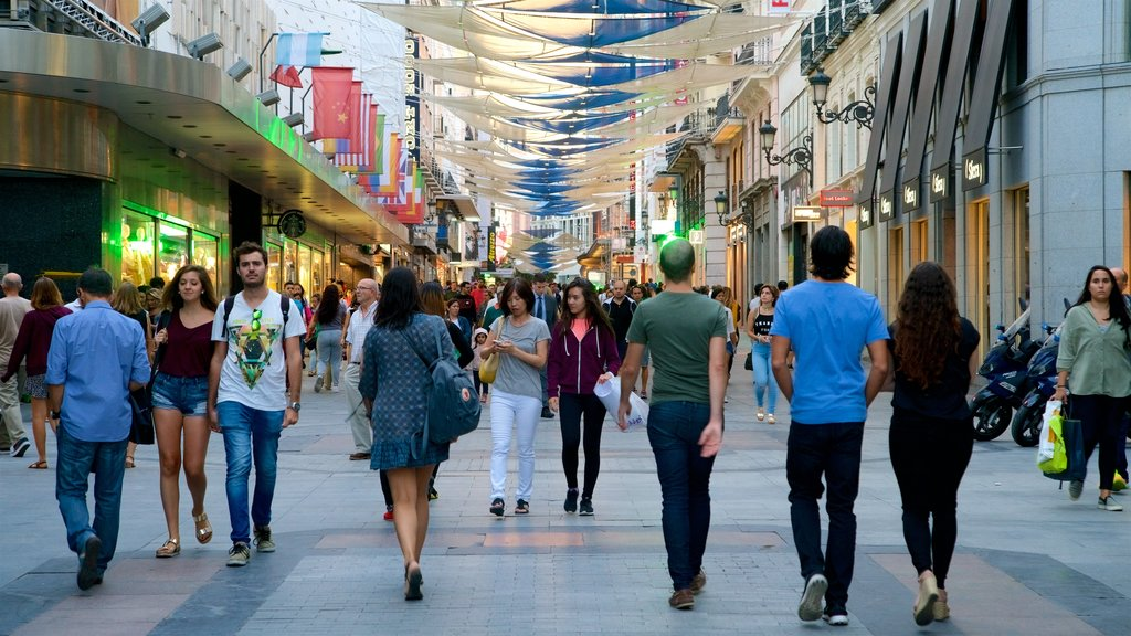 Puerta del Sol which includes city views and street scenes as well as a small group of people