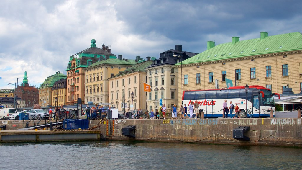 Stockholm showing a river or creek as well as a small group of people