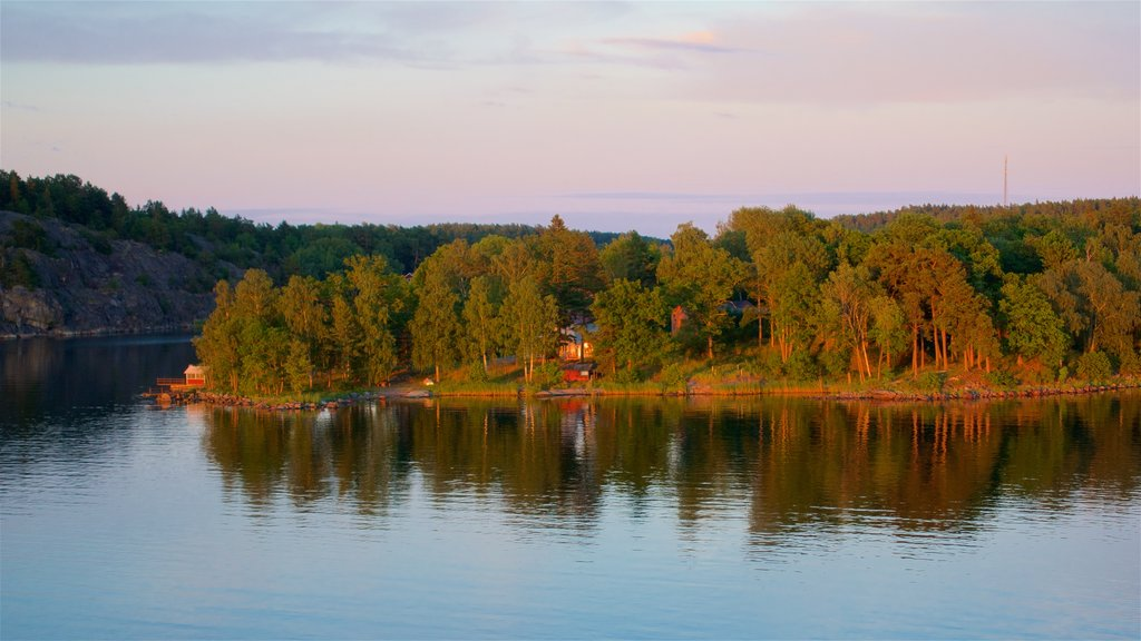 Stockholm showing a sunset, tranquil scenes and a river or creek