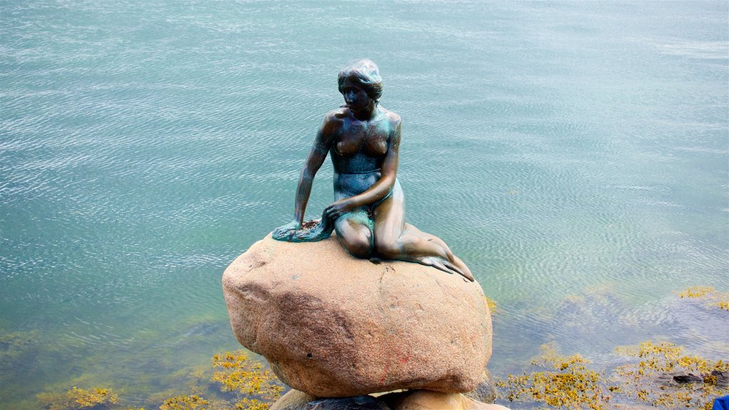 Little Mermaid featuring a lake or waterhole and a statue or sculpture