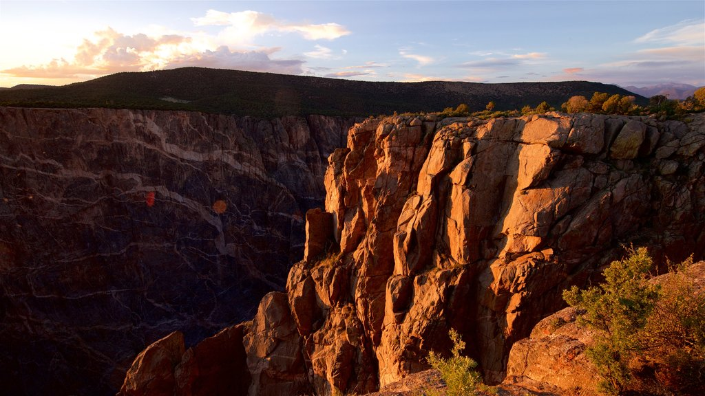 Montrose which includes a gorge or canyon, tranquil scenes and a sunset