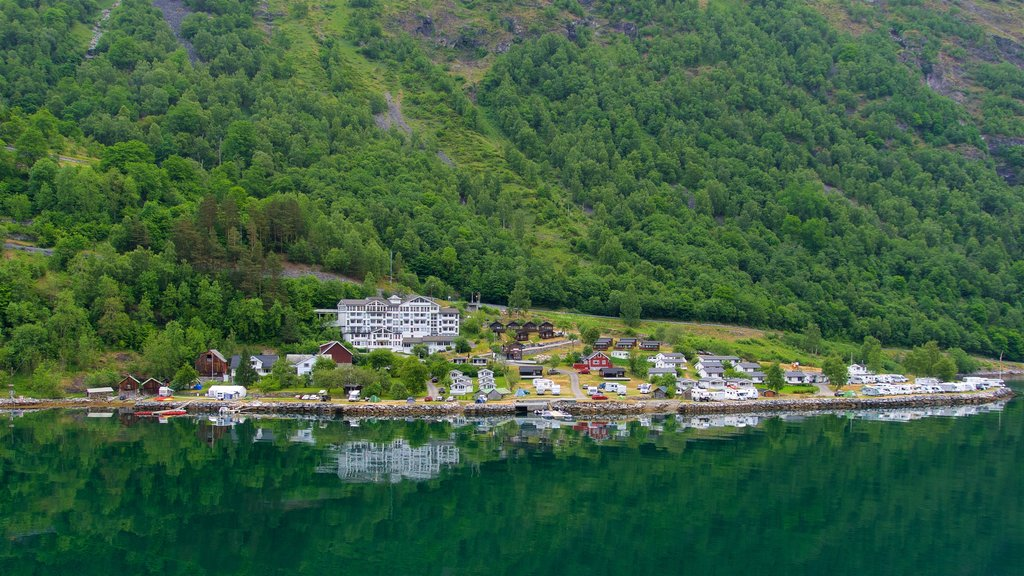 Geiranger which includes a small town or village and a lake or waterhole