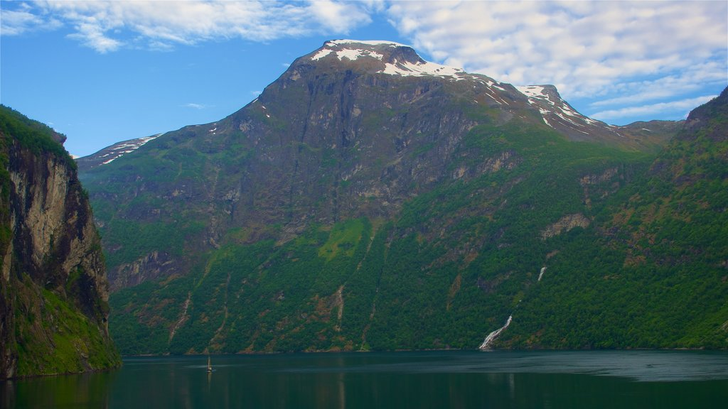 Geiranger which includes mountains and a river or creek