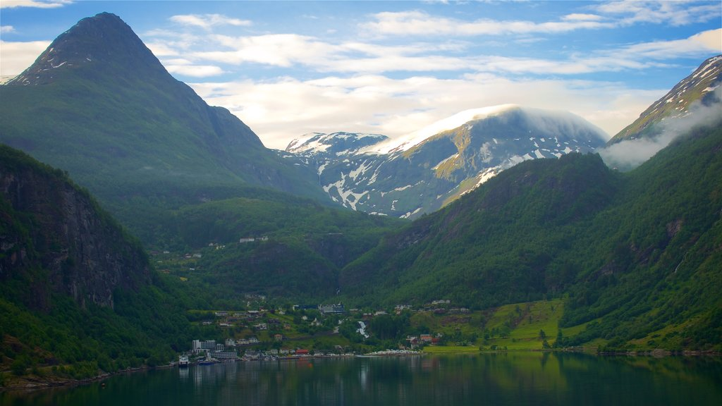 Geiranger featuring mountains, a small town or village and a lake or waterhole