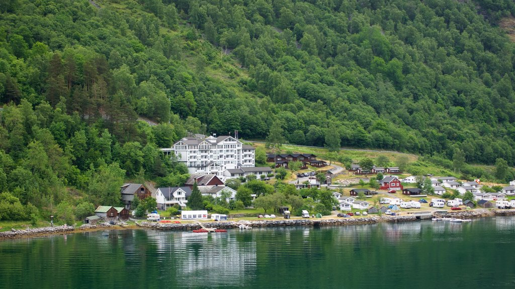 Geiranger which includes a small town or village and a river or creek