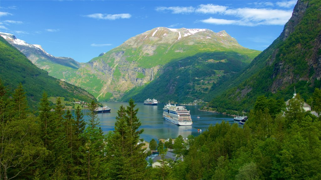 Geiranger featuring cruising, mountains and a lake or waterhole