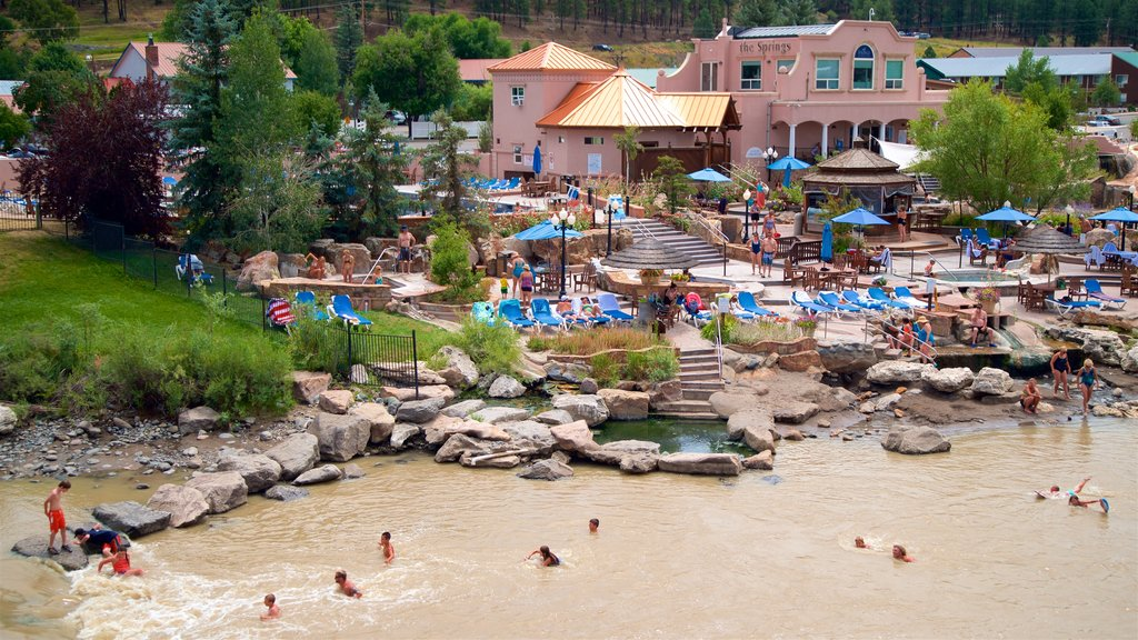 Pagosa Springs showing a lake or waterhole and swimming as well as a small group of people