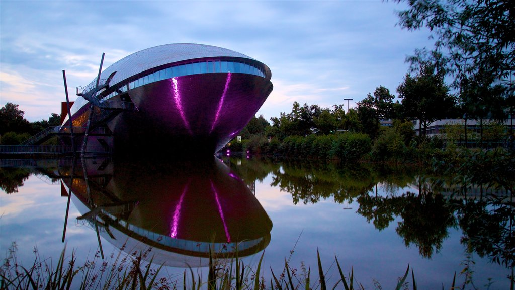 Universum Science Center featuring modern architecture and a lake or waterhole