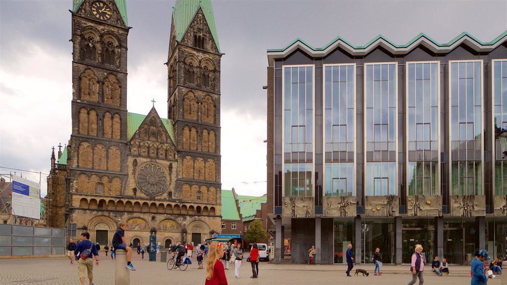 Bremen Cathedral showing heritage architecture and chateau or palace as well as a small group of people