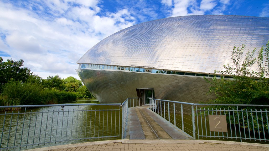 Universum Science Center which includes a lake or waterhole and modern architecture