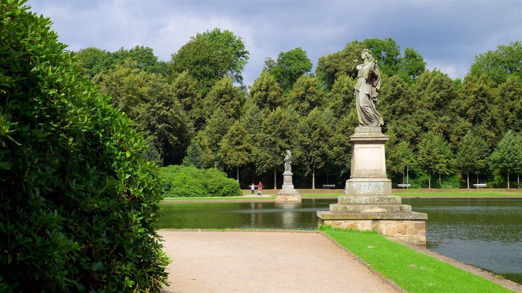 Bremen Buergerpark featuring a statue or sculpture, a park and a lake or waterhole