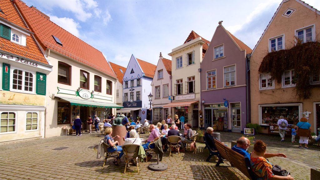 Schnoor Quarter featuring a square or plaza as well as a small group of people