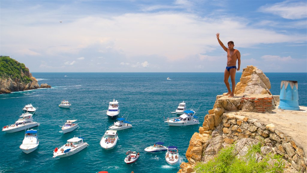 La Quebrada Cliffs featuring boating and a bay or harbor as well as an individual male
