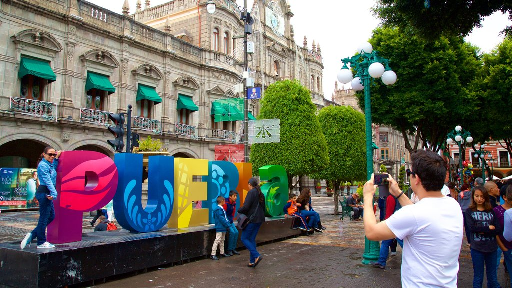 Zocalo Square showing outdoor art and heritage elements as well as a small group of people
