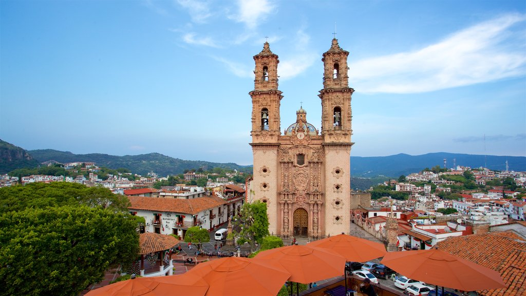Santa Prisca Cathedral showing a church or cathedral, a city and heritage architecture