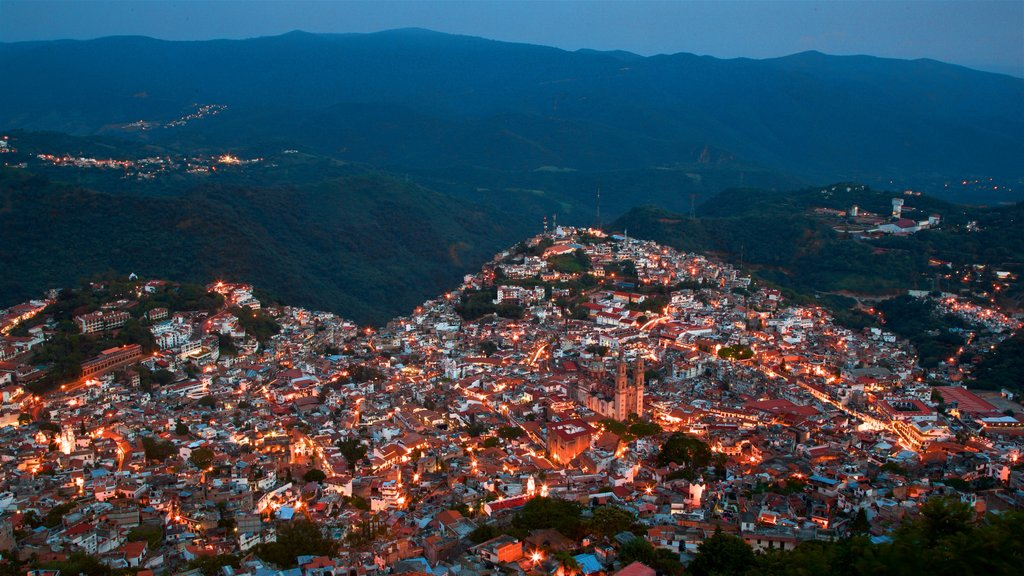 Taxco showing night scenes, a city and tranquil scenes