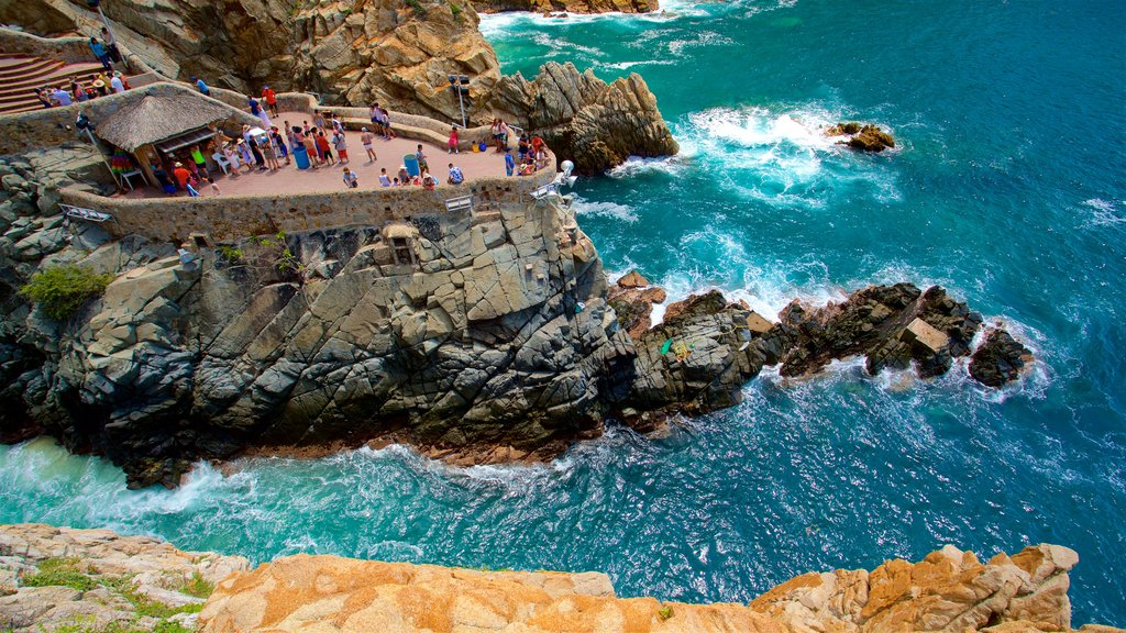 La Quebrada Cliffs which includes rugged coastline as well as a small group of people