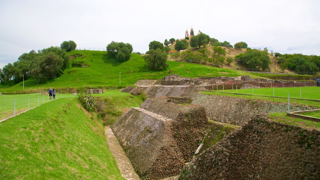 Great Pyramid of Cholula showing heritage elements and a ruin