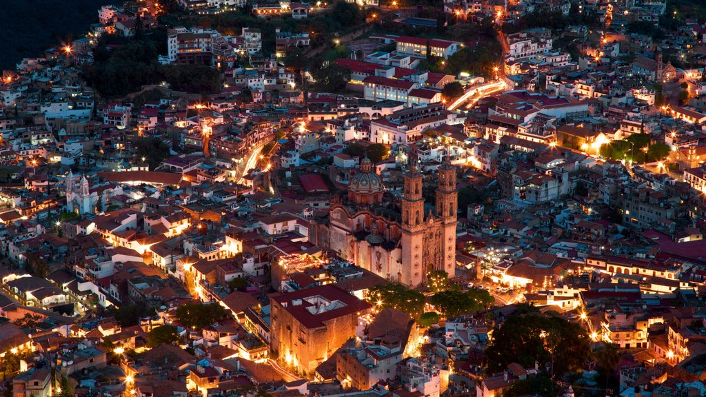 Santa Prisca Cathedral featuring night scenes and a city