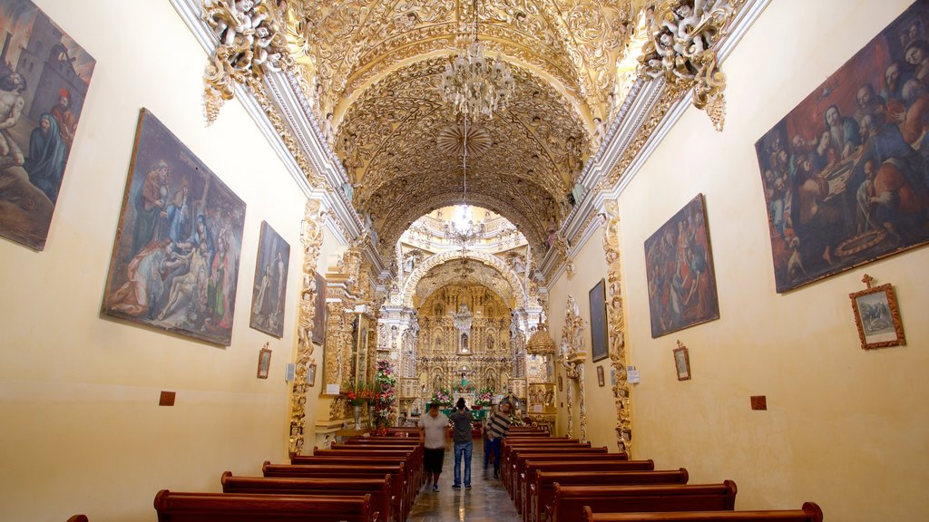 Templo San Francisco Acatepec featuring interior views, art and religious elements