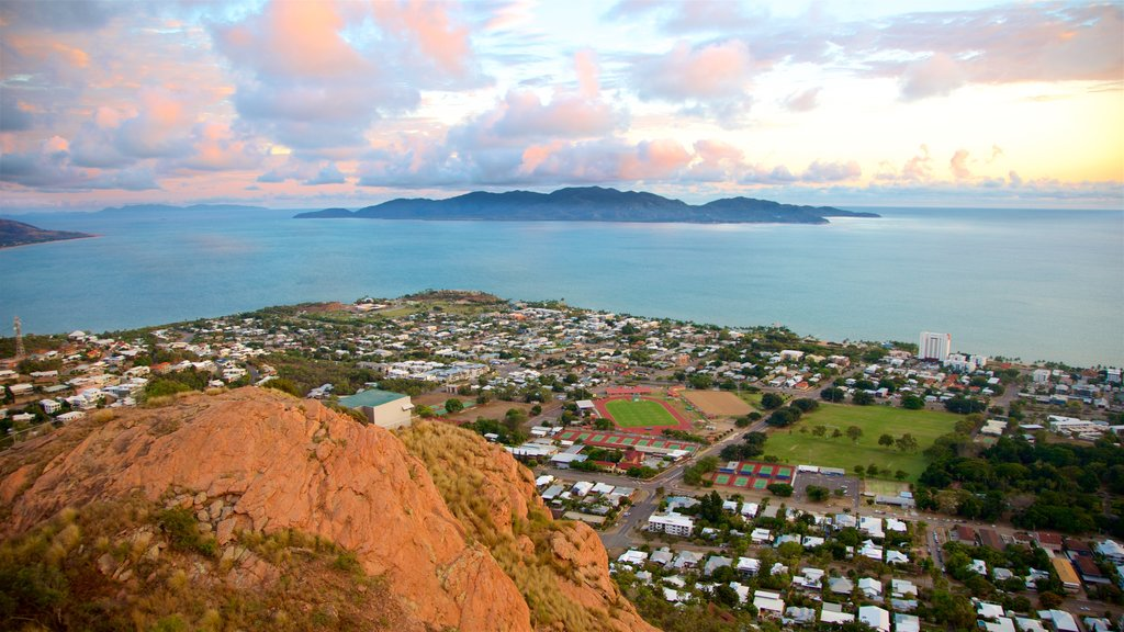 Townsville which includes landscape views, a small town or village and a sunset