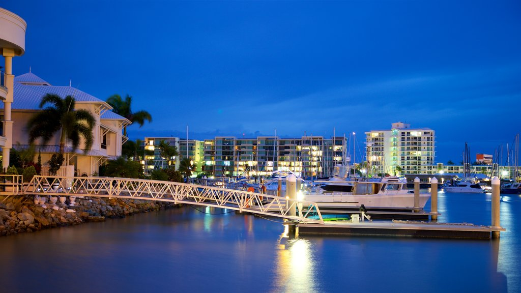 Townsville which includes a bay or harbor and night scenes