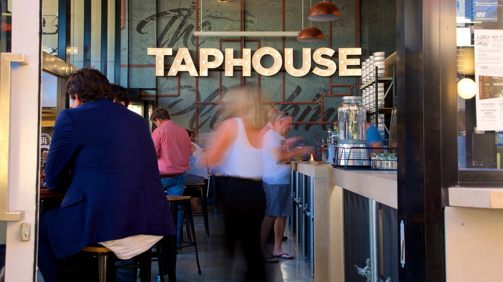 Townsville featuring a bar as well as a small group of people