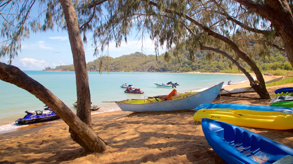 Magnetic Island showing general coastal views, jet skiing and a sandy beach