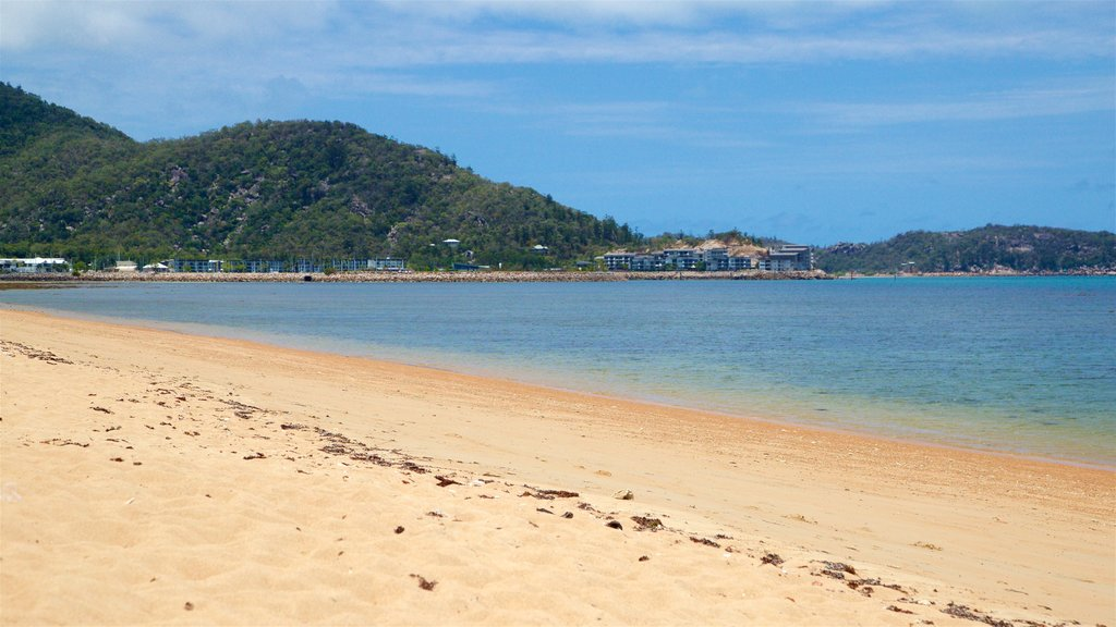 Townsville which includes a sandy beach and general coastal views
