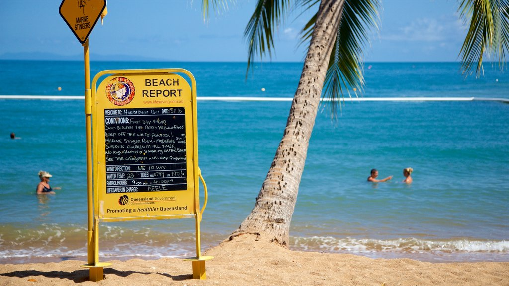 Horseshoe Bay Beach showing signage, tropical scenes and general coastal views