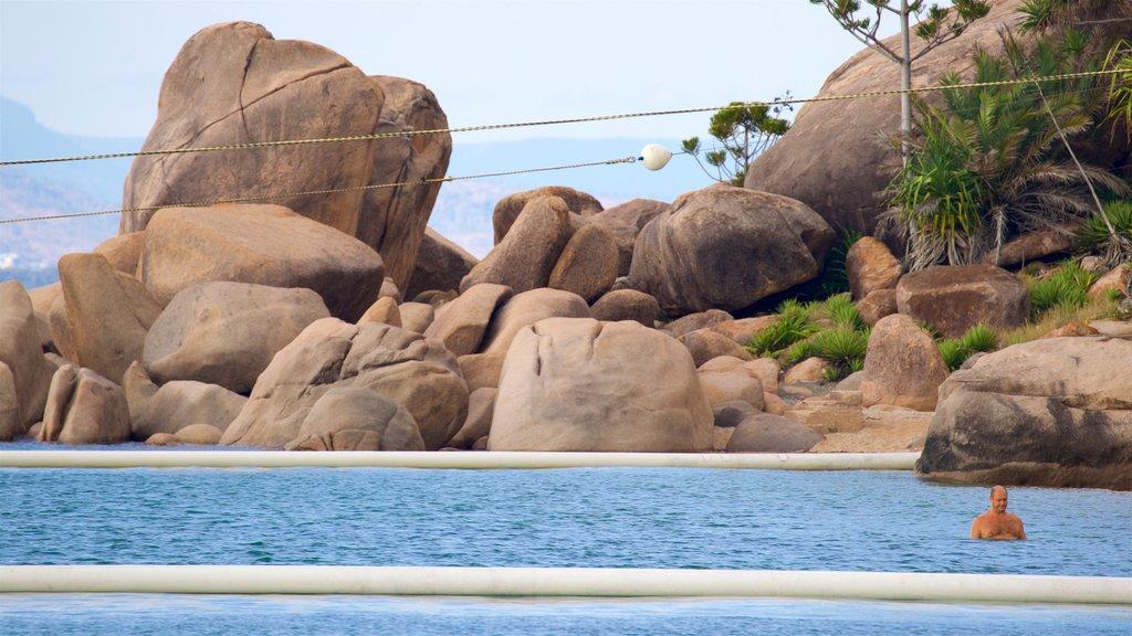 Picnic Bay featuring general coastal views, rocky coastline and swimming