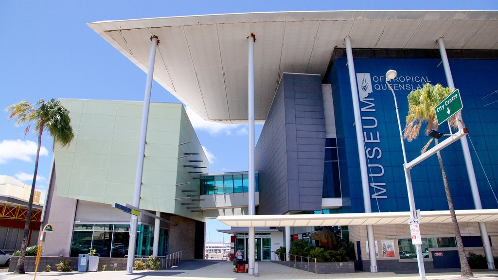 Museum of Tropical Queensland featuring signage and modern architecture