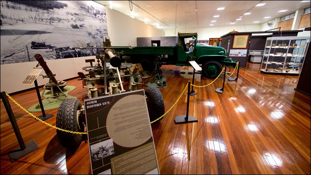 Army Museum North Queensland which includes heritage elements, signage and interior views