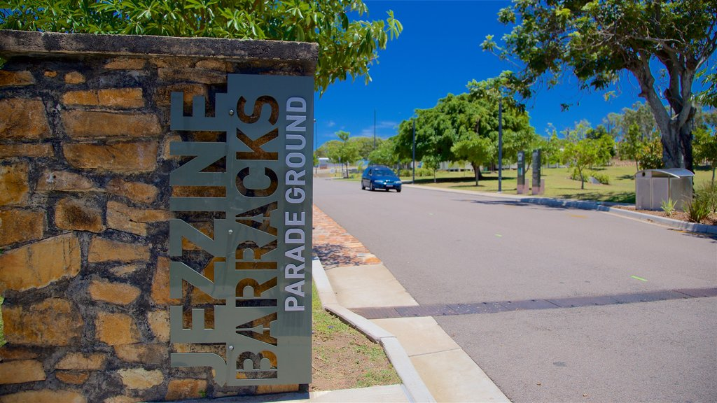 Townsville showing signage and a garden