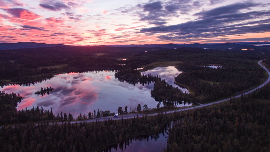 Kiruna which includes a sunset, a lake or waterhole and landscape views